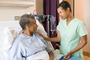 Nurse Talking To Senior Woman